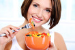 woman with a plate of  vegetable salad in hands