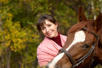 Smiling girl near the horse