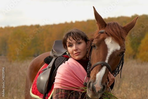 Young girl hugging the horse