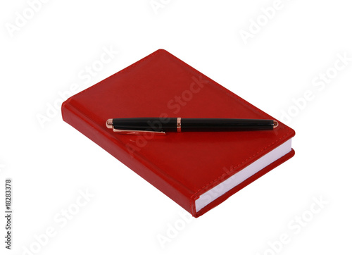 Red  leater notepad and  business pen