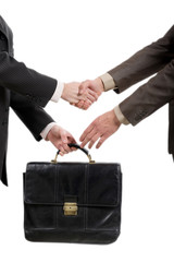 shaking hands and transfer briefcase