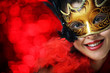Beautiful young woman in carnival mask over red background