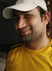 Smiling Indian man in a casual sporty outfit