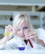 Closeup of a female researcher holding test tubes while carrying