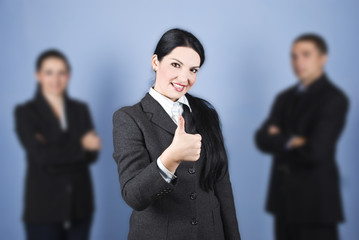 Business woman leader giving thumbs up