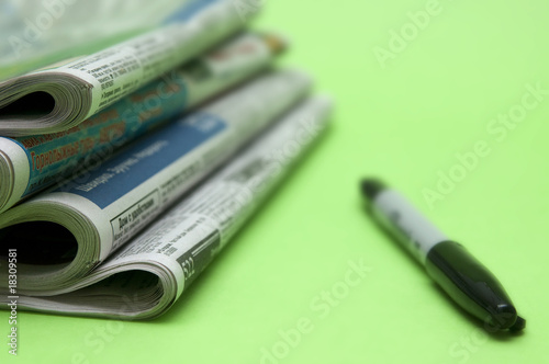 Pack of newspapers and pen