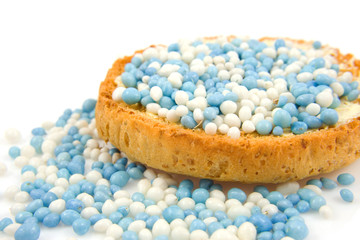 Rusk with blue mice over white background