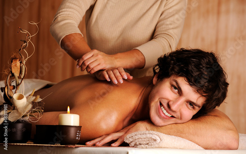 handsome happy young man on massage
