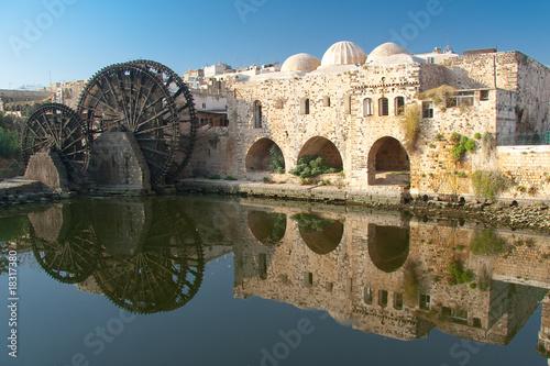 Leinwandbild Motiv Reflejo en Hama, Siria
