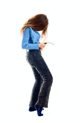 Portrait of cute teen girl try on jeans