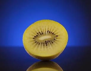 Half kiwi on blue