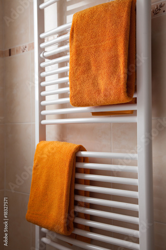 orange towels on heater