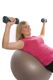 Woman on ball with weights