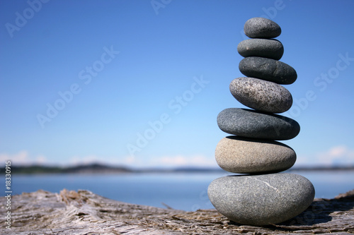 Rocks balancing on log