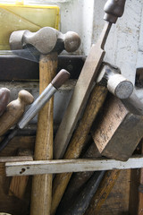 Old Tools in rack on workbench