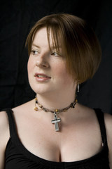 Fresh faced girl with cross necklace