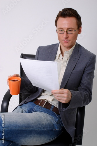 bisinessman reading paperwork