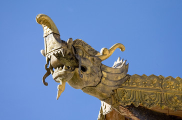 Golden dragon architecture on temple roof, Tibet