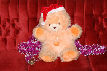 Christmas Teddy Bear wearing Santa's hat