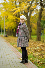 small pretty young girl in park standing with smile turned