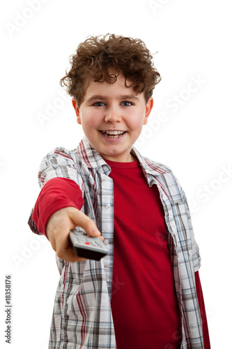 Boy using remote control isolated on white