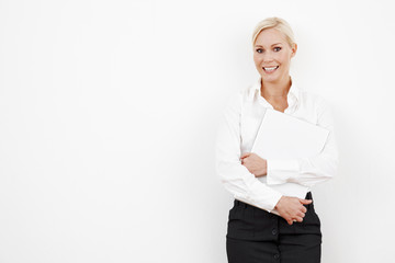Blond businesswoman on white with laptop
