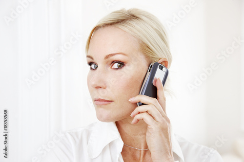 Blond businesswoman with mobile