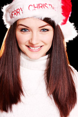 Pretty woman wearing santa hat