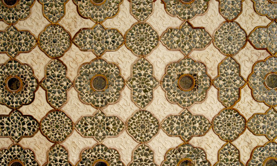 Patterned artwork in the ceiling in Amber Fort palace, India