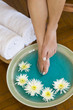 Foot massage with herbs and flowers