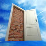 White door put by a bricklaying against the sky poster