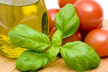 basil, tomatoes and bottle of olive oil
