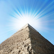 Egyptian pyramids with sun beams.