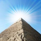 Egyptian pyramids with sun beams.