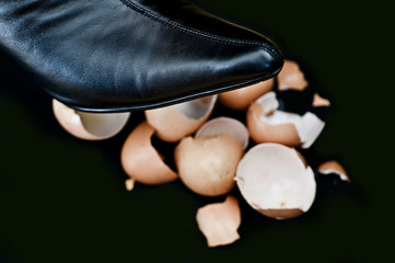 Shoe over broken eggs