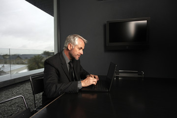 Profile of a businessman with a laptop