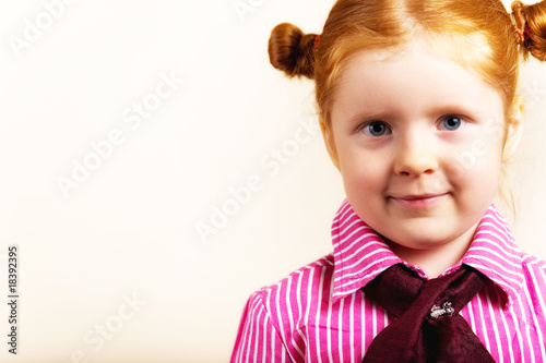 Portrait of cute elegant redhead girl