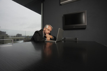 Executive at his luxurious office