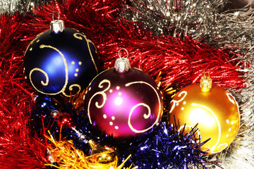christmas balls on abstract tinsel background