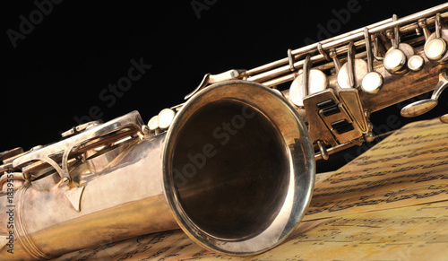 Old saxophone and notes - 18395591