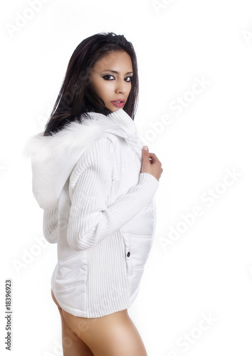 Beautiful sexy fashion model wearing white winter coat