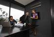 Businesswoman pulling businessman's tie
