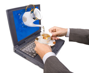pouring tea on notebook