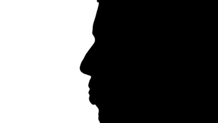 Man sticks tongue out in silhouette - HD