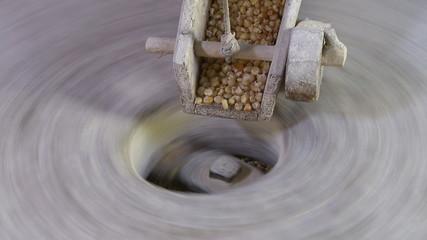Old watermill millstone grinding corn