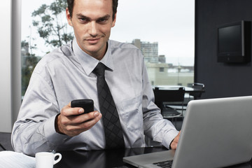 Young businessman with a computer