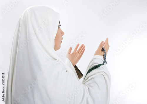Young woman, muslim pilgrim in white traditional clothes
