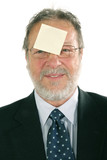 Business man with post it in the forehead poster