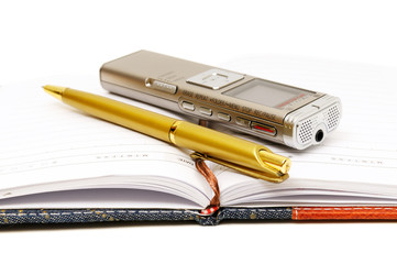 Dictaphone, notepad and ballpen
