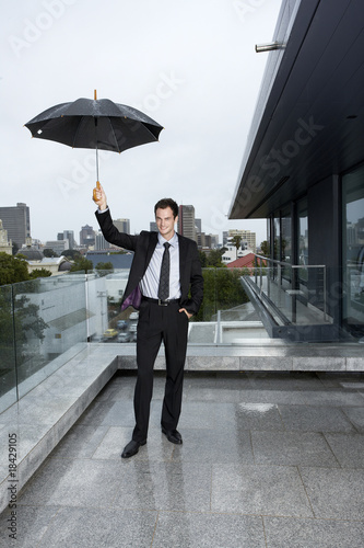 Man standing in the rain